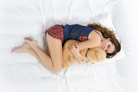 Young woman with teddybear photo