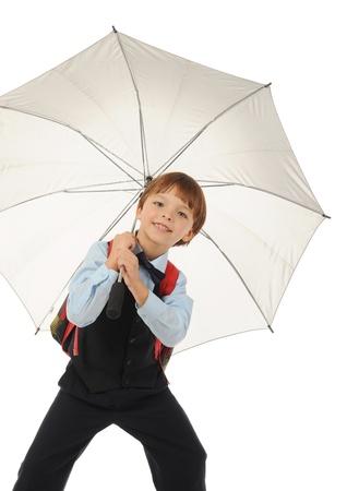 Schoolboy with a umbrella. photo