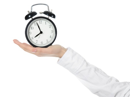 woman with an alarm clock in a hand. Stock Photo - 8954971