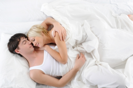 lovely woman: Happy family lying in bed