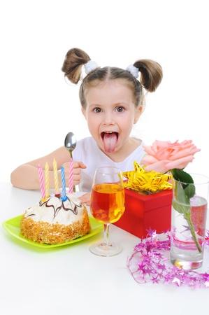 Beautiful little girl celebrates birthday photo