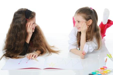 Two sisters draw on the album. Stock Photo - 9125302