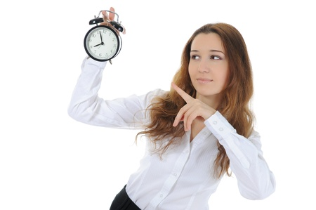 woman with an alarm clock in a hand. photo