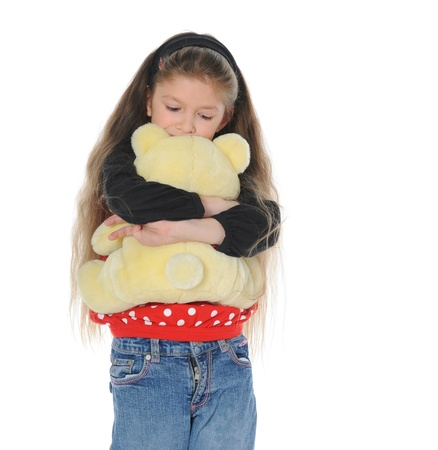 Little girl with toy bear photo