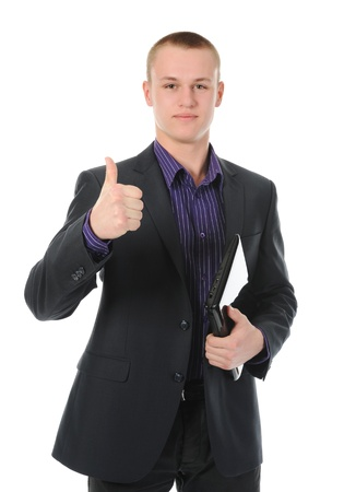 Businessman holding laptop photo