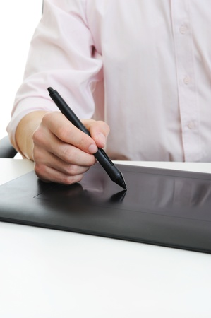 graphic tablet: hand on graphic tablet. Stock Photo