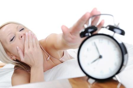 Sleepy woman turns off the alarm Stock Photo - 9125416