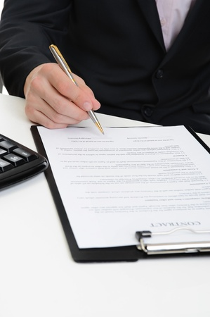 Businessman signs a contract Stock Photo - 9126373