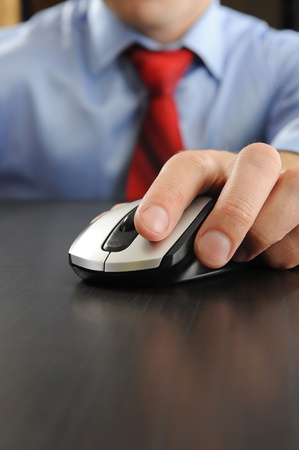 mouse in hand businessman photo