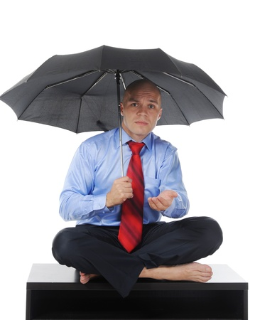 Image of a businessman with umbrella Stock Photo - 9125784