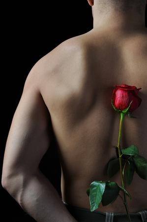 man  holding a red rose Stock Photo - 9125838