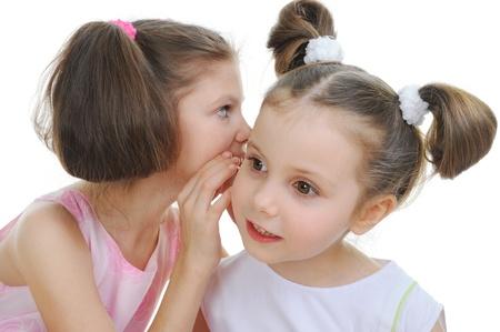 Two beautiful girls telling secret photo