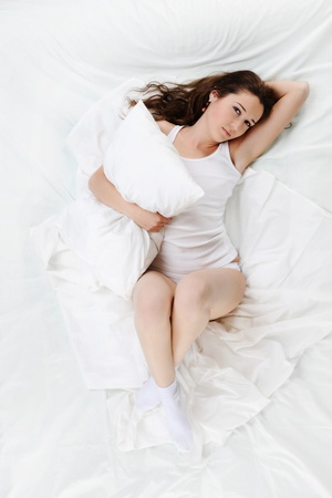 woman sleeping on the bed photo
