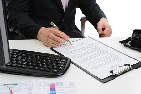 Businessman signs a contract photo