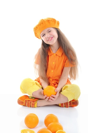 Funny girl with oranges. photo