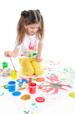 little girl draws photo