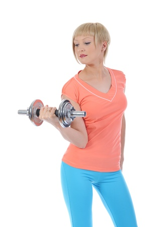 Young beautiful athlete with a dumbbell. Stock Photo - 9241194