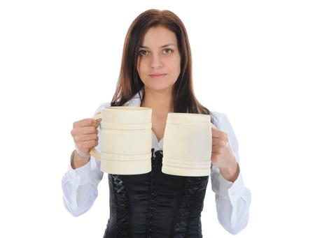 prosit: beautiful woman holds a large wooden beer mug.  Stock Photo
