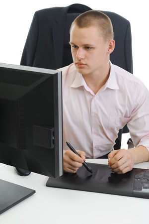 young designer does the work on your computer. photo