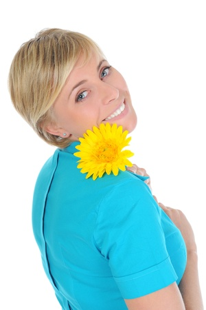 young woman with a yellow flower. photo