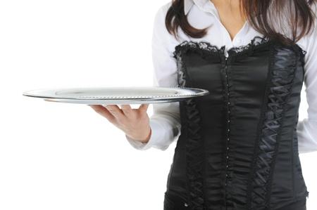 Waiter holding empty silver tray photo