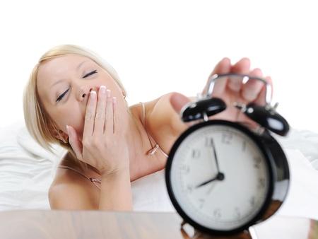 Sleepy woman turns off the alarm photo