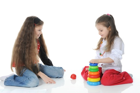 Two sisters draw play toys photo