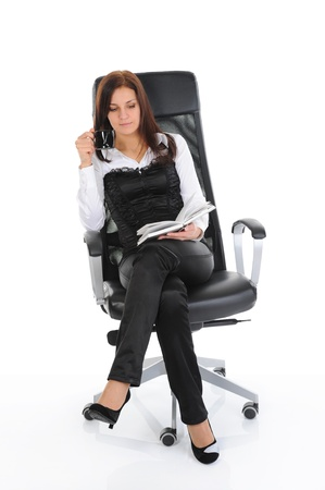 Businesswoman reading a book Stock Photo - 9292833