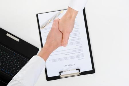 businessman signing documents: Women handshake Stock Photo