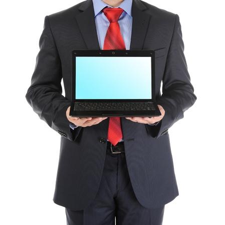 Businessman holding an open laptop photo