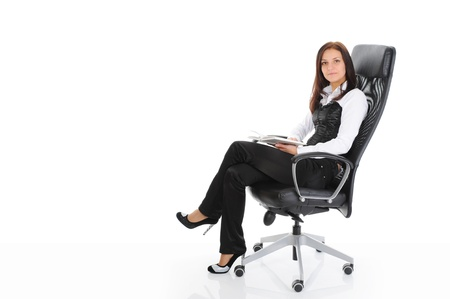young woman sitting on a chair photo