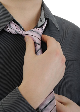 Businessman tying his tie Stock Photo - 9319713