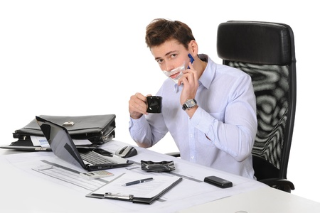 Businessman shaves in the workplace Stock Photo - 9319705