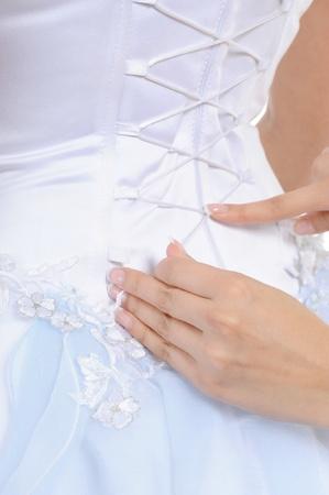 Girlfriend tightens karset bride photo