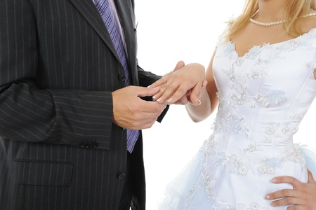 groom wears the ring bride Stock Photo - 9359182