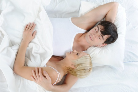 Happy family lying in bed Stock Photo - 9359155