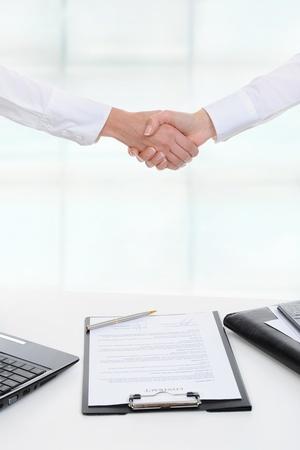 Handshake of two business partners photo