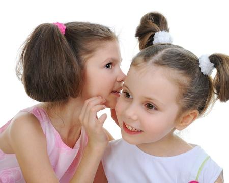 blab: Two beautiful girls telling secret Stock Photo