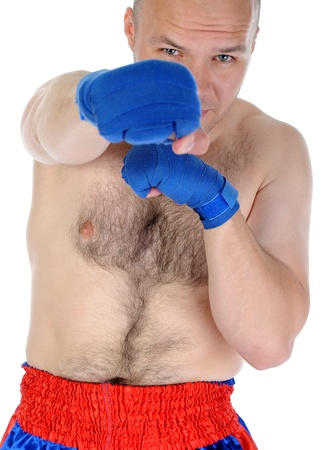 Experienced adult fighter punches during training. photo
