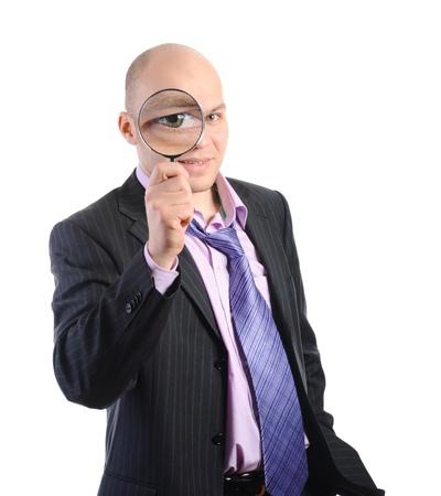 magnifier glass: Businessman in a suit