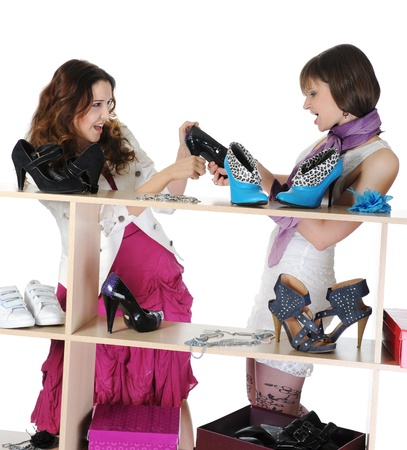 women fighting: woman choosing shoes at a store Stock Photo