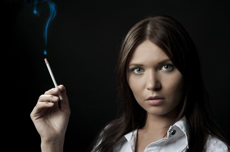 Girl with a cigar in a hand photo
