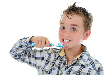 beautiful little boy cleans your teeth photo