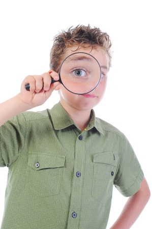 boy looking through a magnifying glass Stock Photo - 9952210