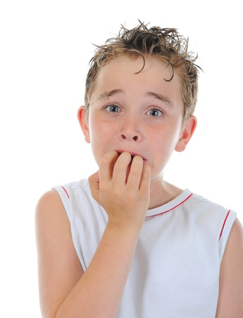 forgetfulness: Portrait of a frightened boy Stock Photo