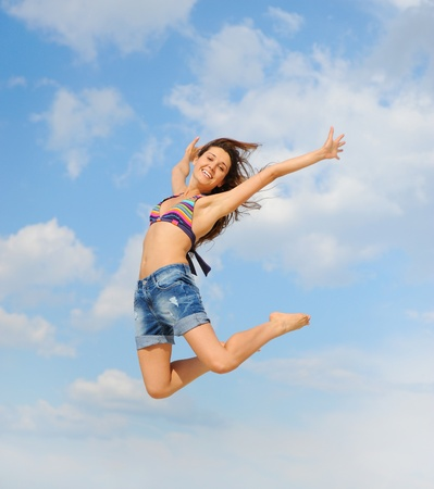 Beautiful Woman over blue Sky photo