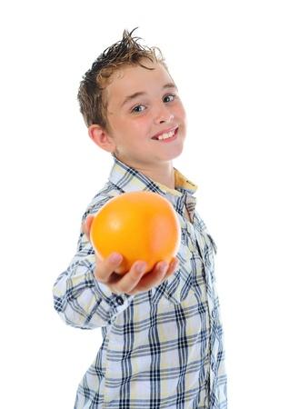 Little kid holding fresh oranges. photo