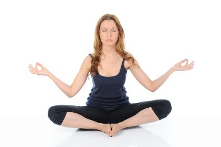 cross leg: mujer de yoga Foto de archivo