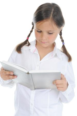 Little girl  holding her book Stock Photo - 9952357