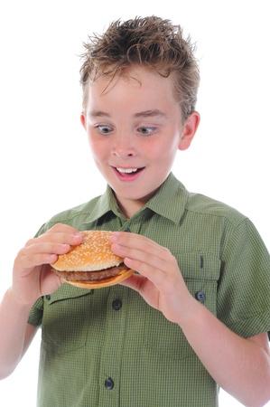 Little boy eating a hamburger Stock Photo - 9951981